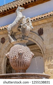 View of fountain in famous Square of Colt (Plaza del Potro). Plaza del Potro named after XVI century octagonal fountain in plaza (1577), prancing horse balanced atop a vase. Cordoba, Andalusia, Spain.