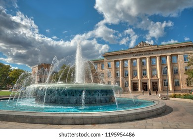 view of the fountain in front of the Regional Court of Ruse, Pyce, Bulgaria, in front of beautiful cloudy skies
