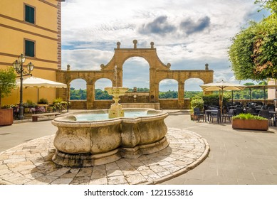 View at the fountain of Place of the Republic in Pitigliano, Italy
