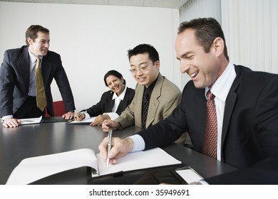 View of four businesspeople in an office meeting.