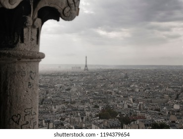 View of France's Eiffel Tower through stone pillars