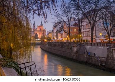 View of Franciscan Church of the Annunciation and Ljubljana River at dusk, Ljubljana, Slovenia, Europe 12-12-2017