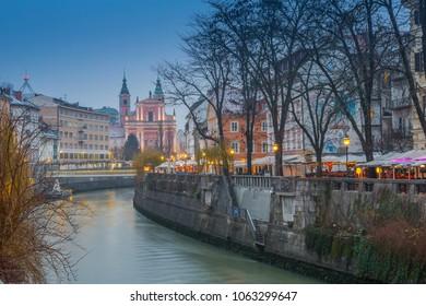 View of Franciscan Church of the Annunciation and Ljubljana River at dusk, Ljubljana, Slovenia, Europe12-12-2017