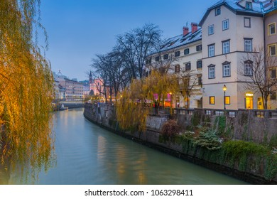 View of Franciscan Church of the Annunciation and riverside houses on Ljubljana River at dusk, Ljubljana, Slovenia, Europe 12-12-2017