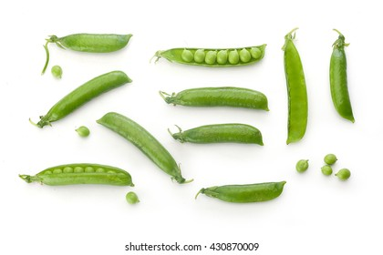 To view of fresh green pea pods and peas on the white background