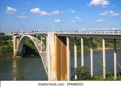 View of the Friendship Bridge (Ponte da Amizade) over the Parana river, connecting Foz do Iguacu, Brazil, to Ciudad del Este in Paraguay.