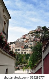 View fro a tiny sidestreet to the houses that cover the steep hillside of Positano, Italy