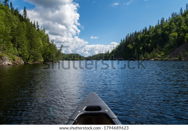 view-front-canoe-on-lake-600w-1794689623