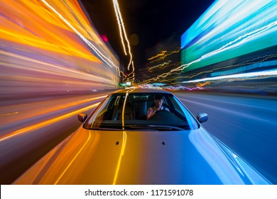 View from Front of Car moving in a night city, Blured road with lights with car on high speed.