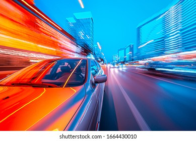 View from Front of Car moving in a night city, Blured road with lights with car on high speed. - Shutterstock ID 1664430010