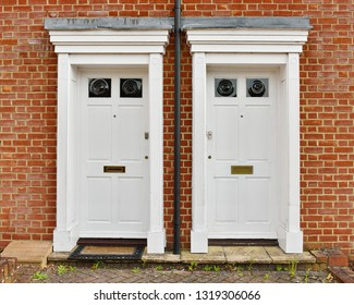 View of Front Doors of Two Traditional Neighbouring Red Brick English Town Houses on a Residential Estate