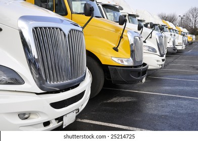 view of the front end of large trucks in a row