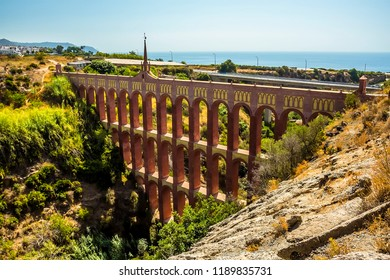 A view of front face of the majestic, four storey, Eagle Aqueduct showing the Mudejar decoration near Nerja, Spain in summertime
