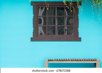 View from the front of the wooden brown window on the blue house