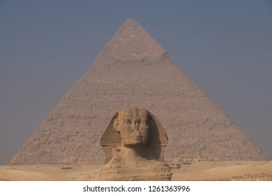 View frontal to pyramid of giza with sphynx in the center front