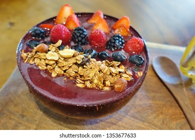 View of a frozen acai bowl with fresh fruit and cereal
