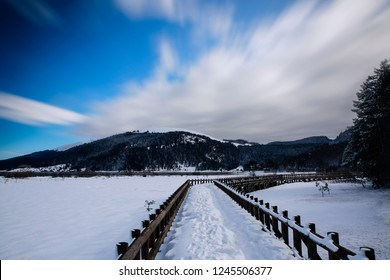 view of frozen lake on bridge in front of mountain in Abant Lake
