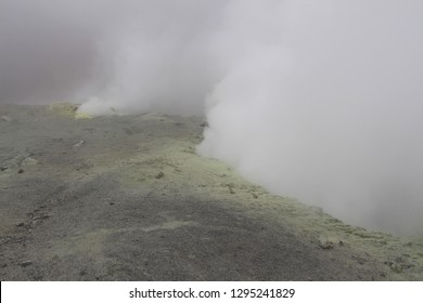 View of the fumarole field in the Mutnovsky volcano on the Kamchatka Peninsula, Russia. A fumarole is an opening in a planet's crust, which emits steam and gases such as carbon dioxide, sulfur dioxide