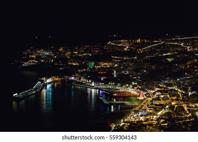 View of Funchal harbor and city at night.