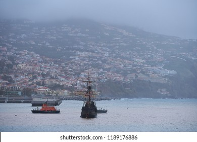 View of Funchal, Madeira from the Marina with a caravel boat on the sea