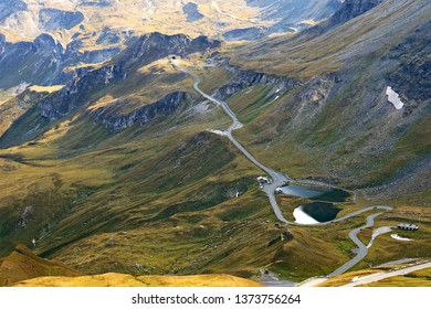 View of the Fuscher lake and Grossglockner High Alpine Road (Hochalpenstrasse). The windy road with 36 bends that leads to the heart of the Hohe Tauern National Park in Austria