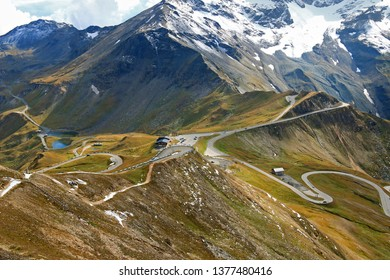 View of the Fuscher lake and Grossglockner High Alpine Road (Hochalpenstrasse). The windy road with 36 bends that leads to the heart of the Hohe Tauern National Park in Austria.