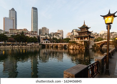 View of the Fuyu bridge and Jiaxiu tower in Guiyang old town which contrast with modern towers in Guizhou province in China