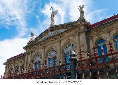 View of the gable roof of National Theater in Costa Rica downtown square with angle, beautiful blue sky and copy space for text.