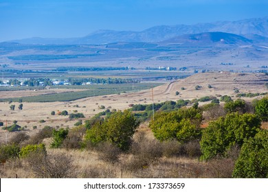 View from Galilee Mountains near Galilee Sea, Kinneret, Israel. Golan Heights. Wonderful landscape with blue fog on the background and bright colors. Gradient from green to blue.