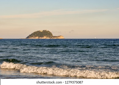 View of the Gallinara Island at sunset;  thanks to its rare Mediterranean vegetation and its uncontaminated environment, has become a Regional Natural Park. Alassio, Liguria, Italy