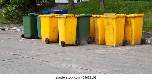 A view of garbage bins neatly standing by the street.