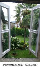 View to the garden through a vintage window