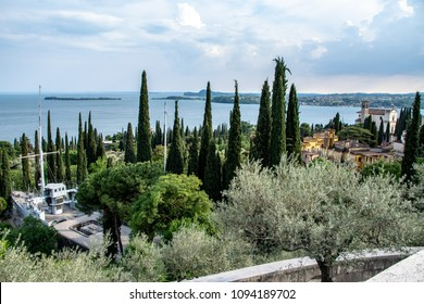 View of the garden of the Vittoriale degli Italiani with a war ship in the middle of the garden, this is the last house of the poet Gabriele D'Annunzio in Gardone Riviera on lake Garda.