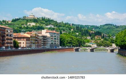 View of the Garibaldi Bridge (Ponte Garibaldi) and the Sanctuary of the Madonna of Lourdes (Santuario della Madonna di Lourdes) in Verona, Italy.