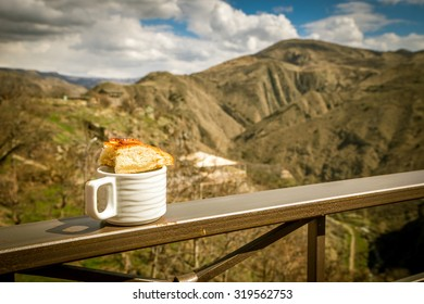 View with Garni temple and cup and bread, Autumn, Armenia