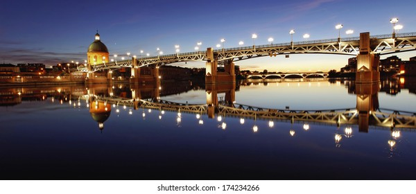 View of Garonne river in Toulouse city center at sunset
