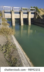 view of a gate in an irrigation canal