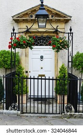 View of a Gated Entrance and Front Door of a Beautiful Old English Town House