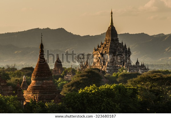 View to the Gawdawpalin Temple in the Bagan Area in front of the surrounding hills at late afternoon