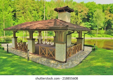 View of the gazebo on the lake. This house is equipped with a beautiful fireplace for grilling.