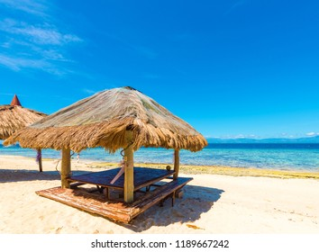 View of the gazebo on the sandy beach in Moalboal, Cebu, Philippines. Copy space for text