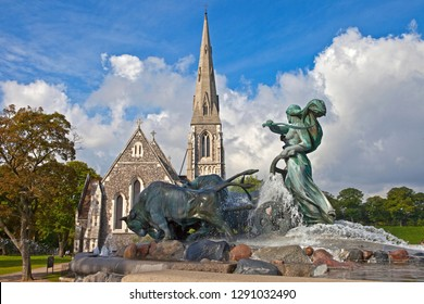A view of the Gefion Fountain with St. Albans Church in the background, in Copenhagen, Denmark.