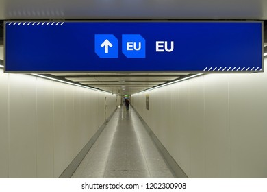 View of a Generic UK/EU Lane Sign above an Empty Walkway at a British Airport