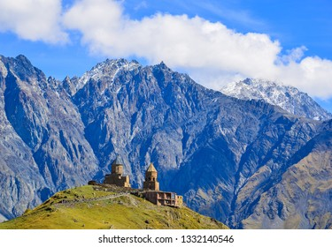 View of Gergeti Trinity Church (Tsminda Sameba) in Kazbegi, Georgia. The Church near the village of Gergeti, under Mount Kazbegi.