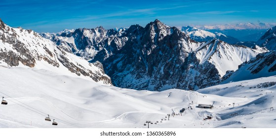 View from the German Zugspitze across the top of a snow mountain landscape