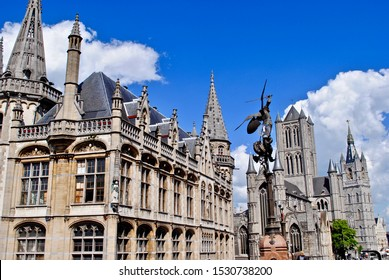 View of Ghent, Belgium from the Saint Michael Bridge (Sint-Michielsbrug). Features a lantern with a bronze statue of St Michael. Saint Nicholas' Church, post office, and Korenmarkt in the background.
