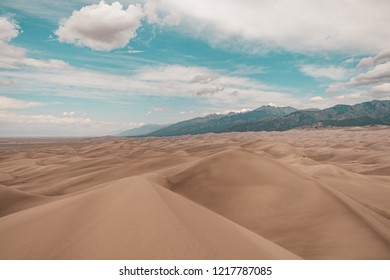 A view of giant desert sand dunes from Star Dune, the tallest dune in Great Sand Dunes National Park in Colorado, USA