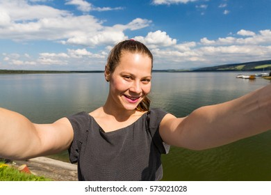 View of a girl at the barrier lake Oravska Priehrada in northern Slovakia