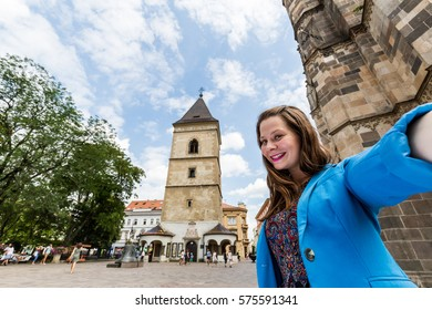 View of a girl in front of the The Urban Tower in Kosice, Slovakia - Shutterstock ID 575591341