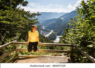 View of a Girl on the outlook viewpoint Il Spir at the Rhine Valley, Flims, Switzerland